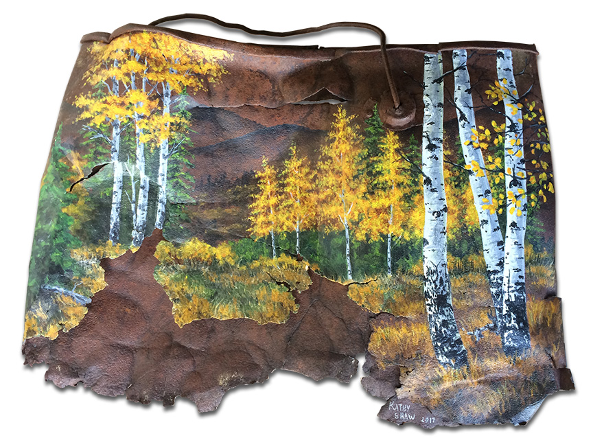 Old rusted bucket with aspen scene