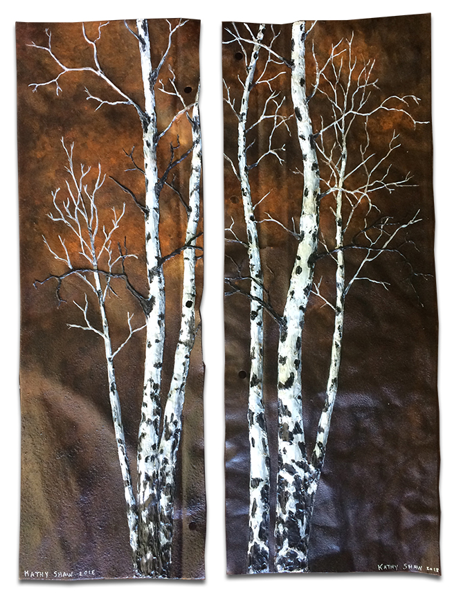 A set of rusted metal pieces with aspens
