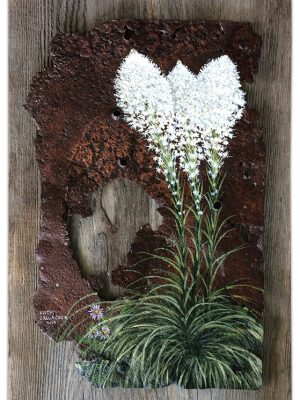 Bear grass on rusted metal with barn wood back