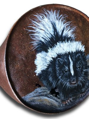 Skunk on old crushed can