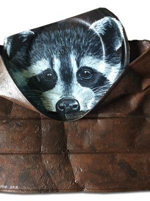 Raccoon on crushed coffee can
