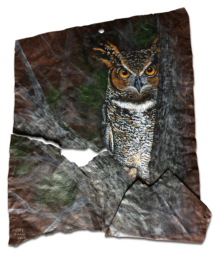 Great horned owl on rusted metal