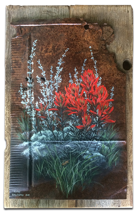 Indian paint brushes on metal mounted on barn wood