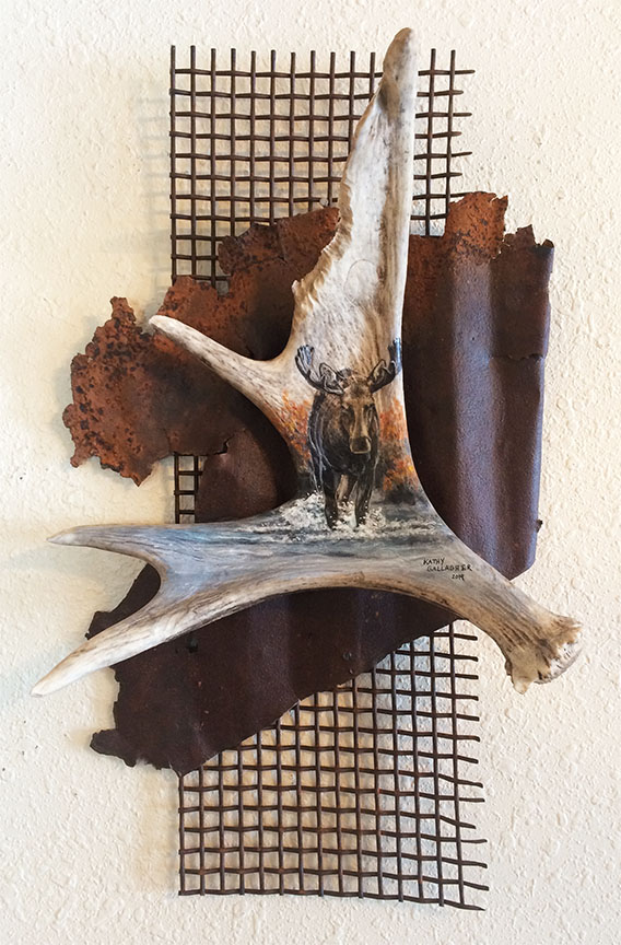 """Moose in arylic on horn attached to metal and rusted screen - Approx. 12"""" x 21"""""""