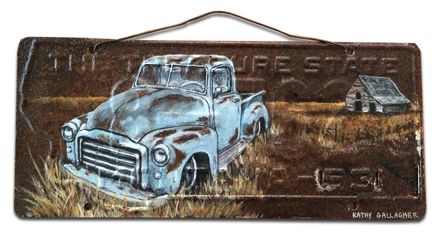 1953 Montana license plate with abandoned farm scene