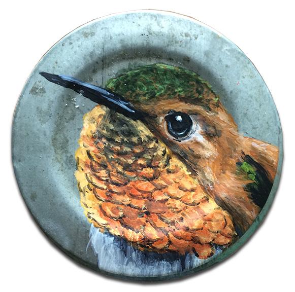 Hummingbird on old mason jar lid