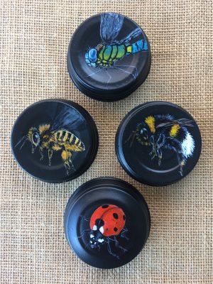 Assorted bugs on mason jar lids