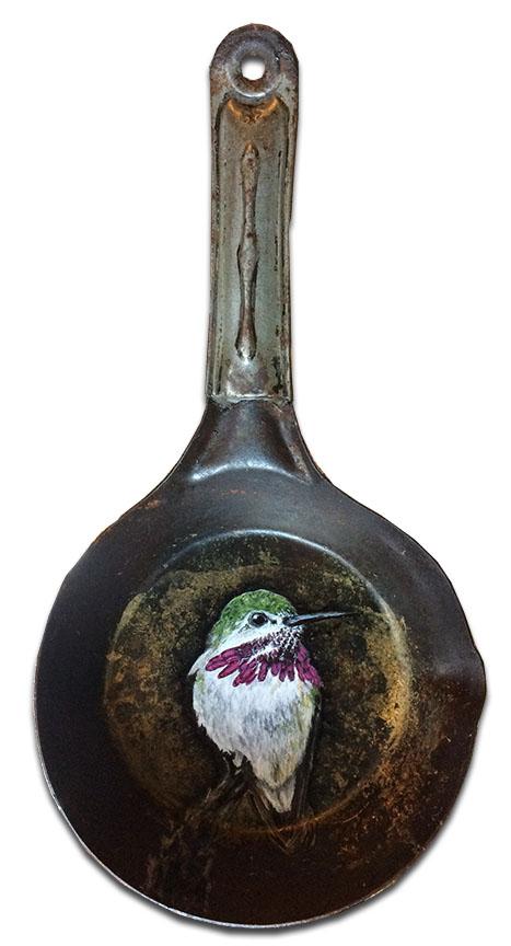 Hummingbird on small metal pan