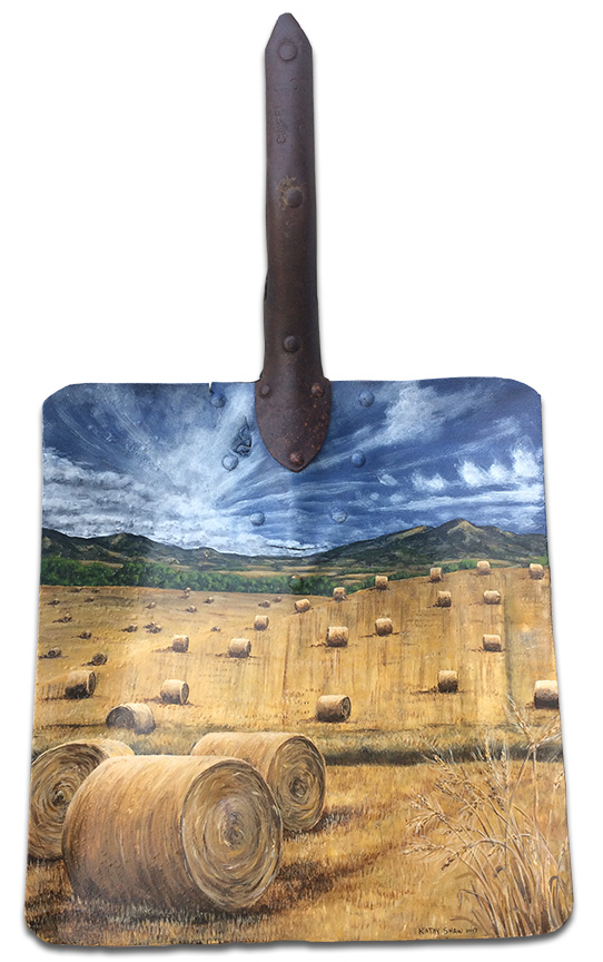 Old rusted shovel with straw bale scene