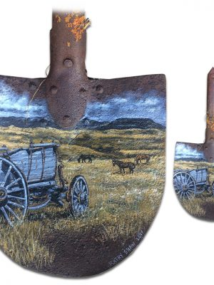 Old rusted shovel with old wagon and horses