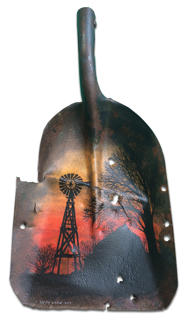 Old rusted shovel with windmill sunset scene