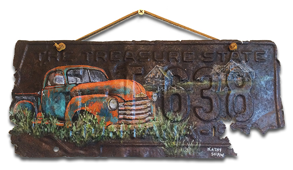 Montana License Plate with abandoned truck