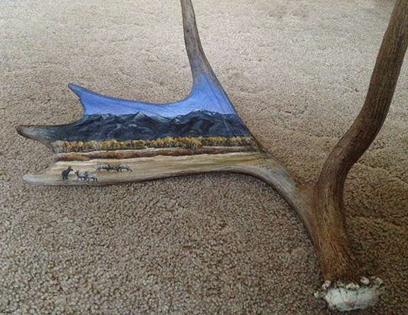 Moose horn painting of elk fighting