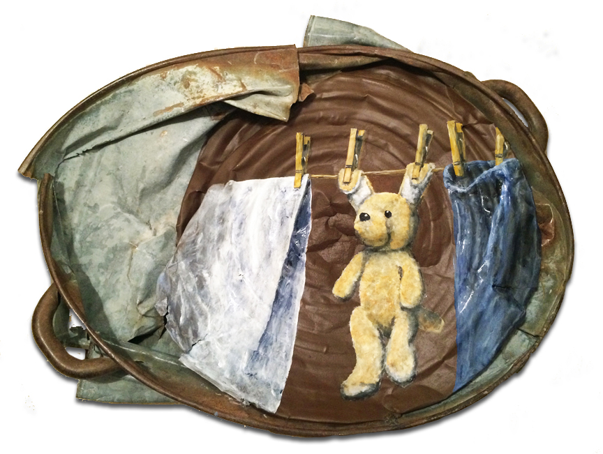 Old rusty wash tub with clothes line and teddy bear