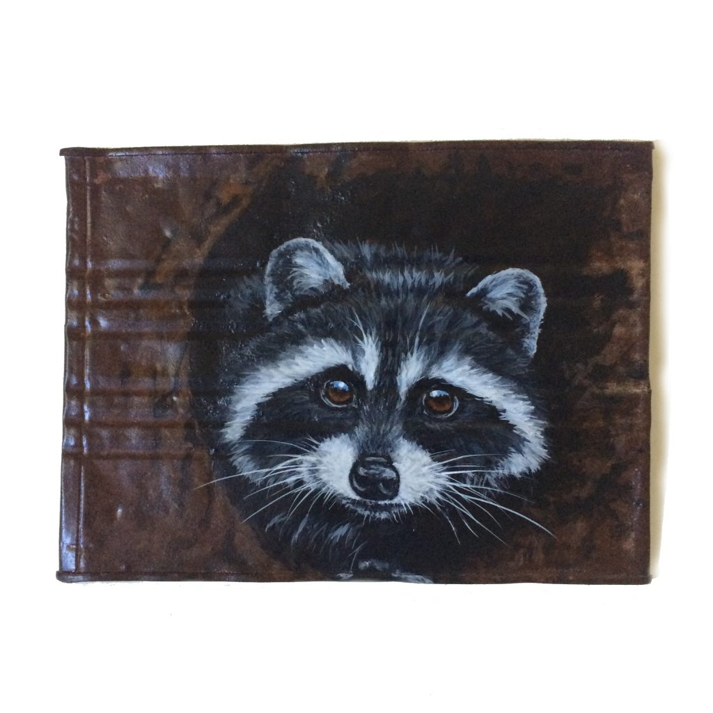 Crushed coffee can with raccoon