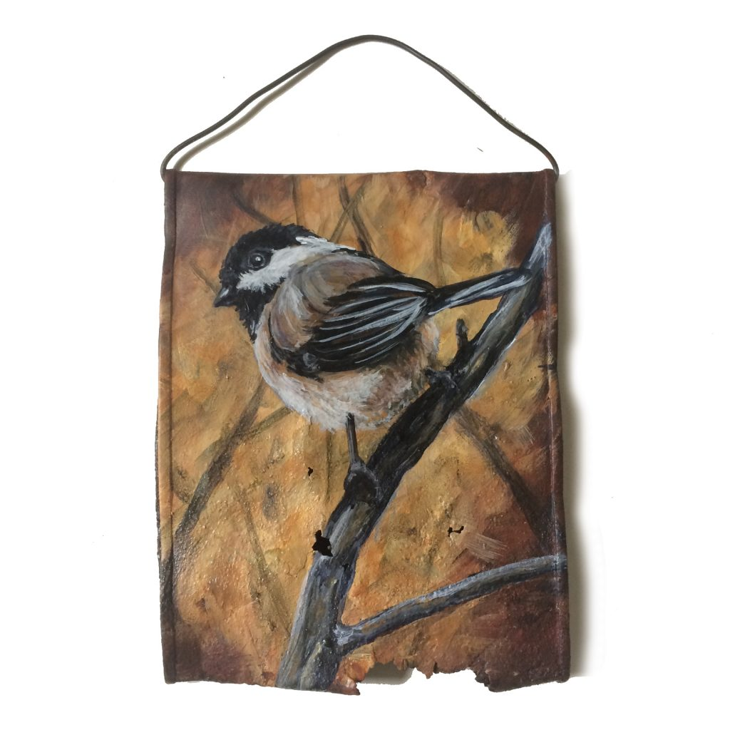 Crushed soup can with Chickadee