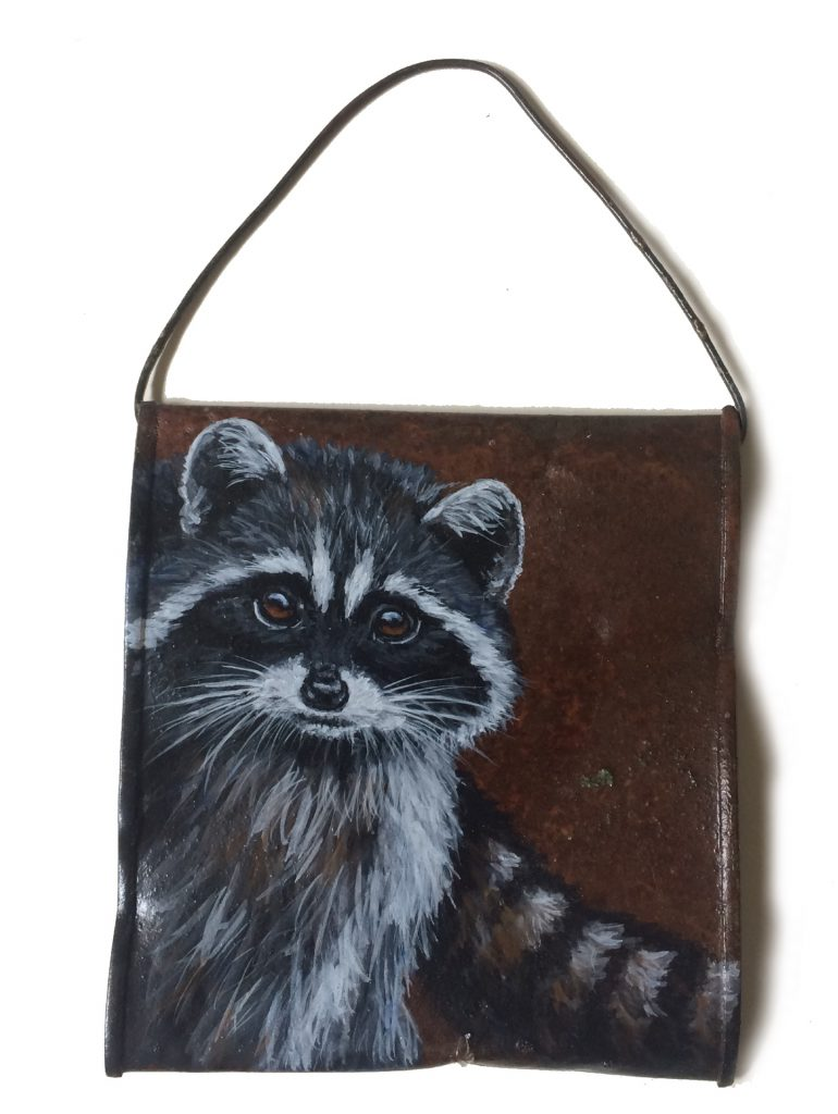 Crushed soup can with raccoon