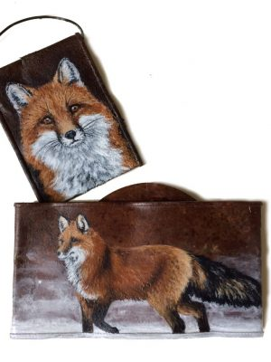 Crushed soup cans with foxes