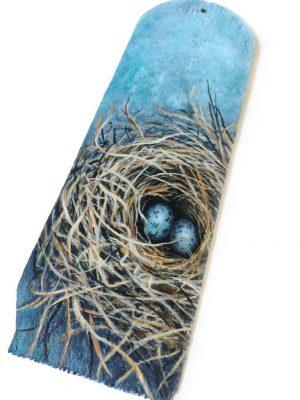 Wood shingle with birds nest