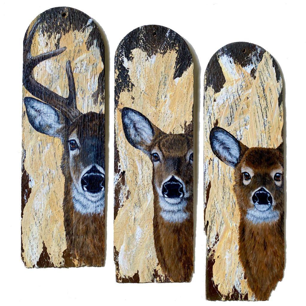 Deer family on wood shingles