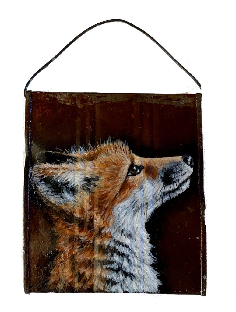 Baby fox on crushed soup can