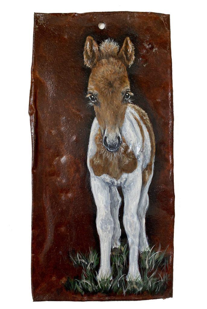 Foal on rusted metal
